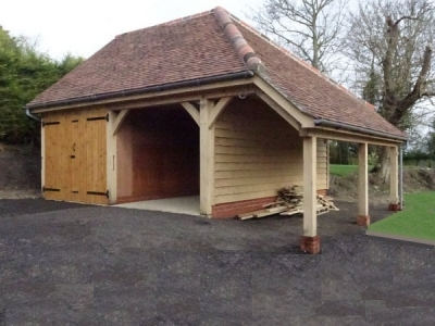 Double cartlodge with log store in Kersey