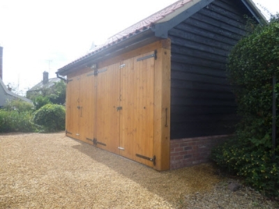 2 Car Cart Lodge with T&G joinery doors at Weatherden in Suffolk
