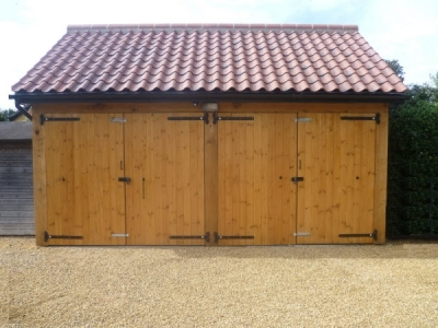 Double Garage with T&G joinery doors at Weatherden in Suffolk