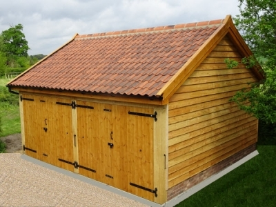 2 bay cart lodge with larch cladding & aged pan tiles, in Wickham Skeith.