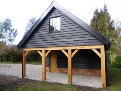 Feature Open Oak Bay in 3 Bay Cart Lodge. Forward Green