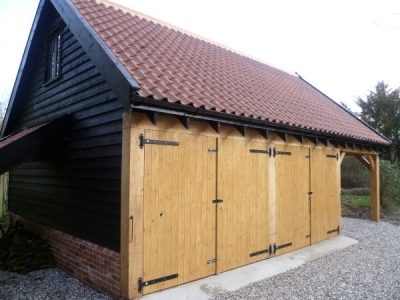 Oak frame Garage with Room Over & Log Store. Forward Green