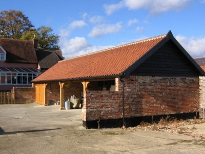 4 Bay Cart Lodge with Oak Garage Doors on 1 bay. Suffolk