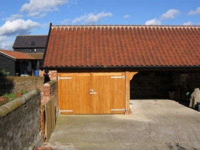 4 Bay Oak framed Cart Lodge built in farm yard. Suffolk